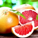 Grapefruit On Top Of Wooden Table   Growing Grapefruit From Seed in 5 Easy Steps   Featured