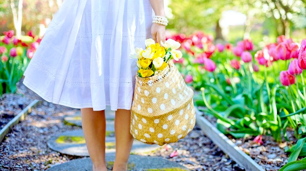 Woman With Flower Basket | DIY Spring Garden Ideas To Get Ahead This Growing Season | Featured